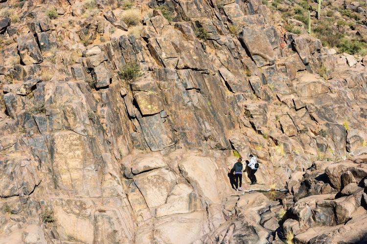 Full length of man climbing on rock