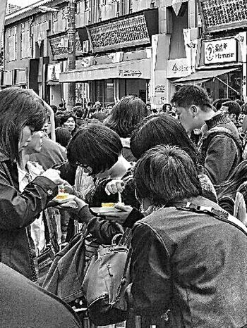 Tucking In Tamagoyaki Japanese Omelette Eggs Tsukiji Tokyo Japan Travel Photography Street Photography Black & White