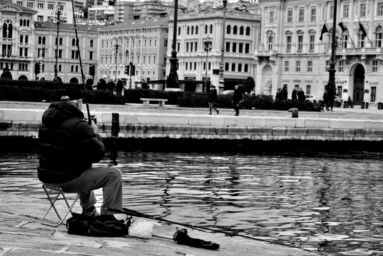 Full length of man on water in city