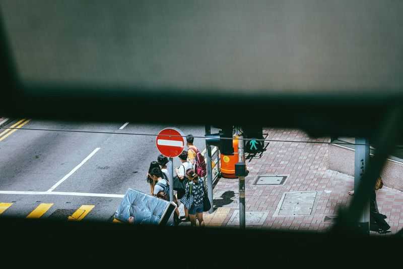 Waiting for the signal 🚦 Real People Adult Sports Race Day Traffic Lights Outdoors People Peek Peeking Through SneakPeek Hong Kong View From The Window... Crosswalk Crossing Stop Sign The Week On EyeEm Asian  Asian Culture Cityscape Urban Lifestyle HongKong Minimalism Minimalobsession Tourist Connected By Travel