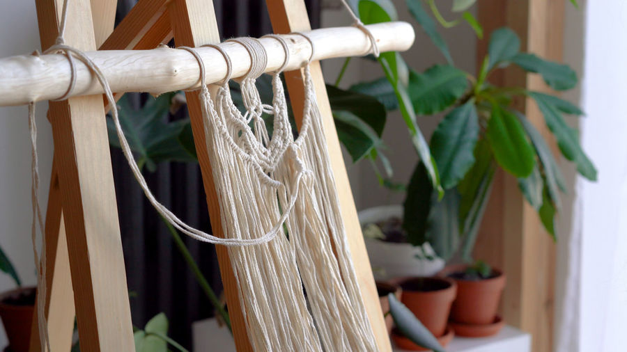Close-up of thread on wood at home