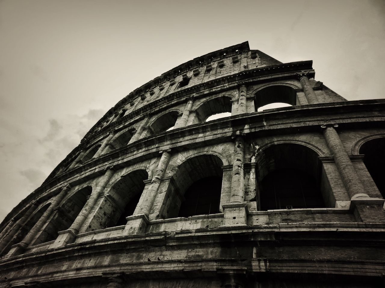 low angle view, architecture, history, built structure, arch, travel destinations, building exterior, sky, travel, outdoors, no people, ancient, ancient civilization, day