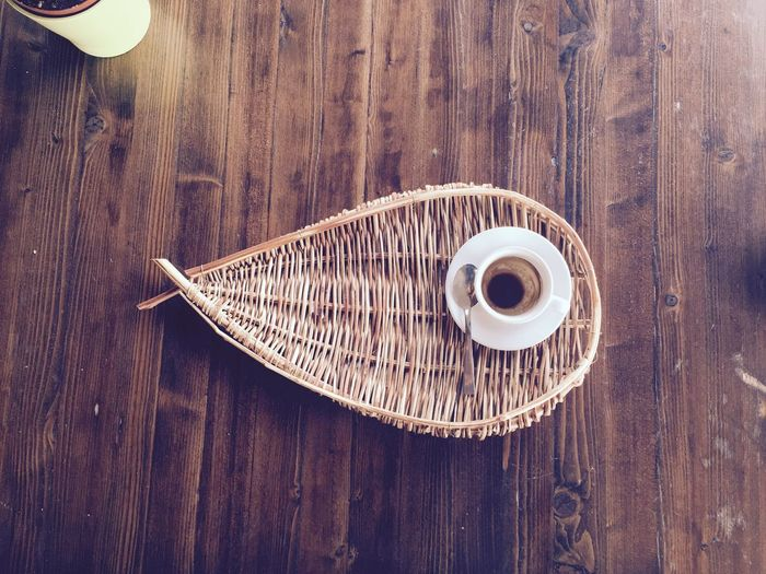 High Angle View Of Empty Coffee Cup On Wicker Serving Tray