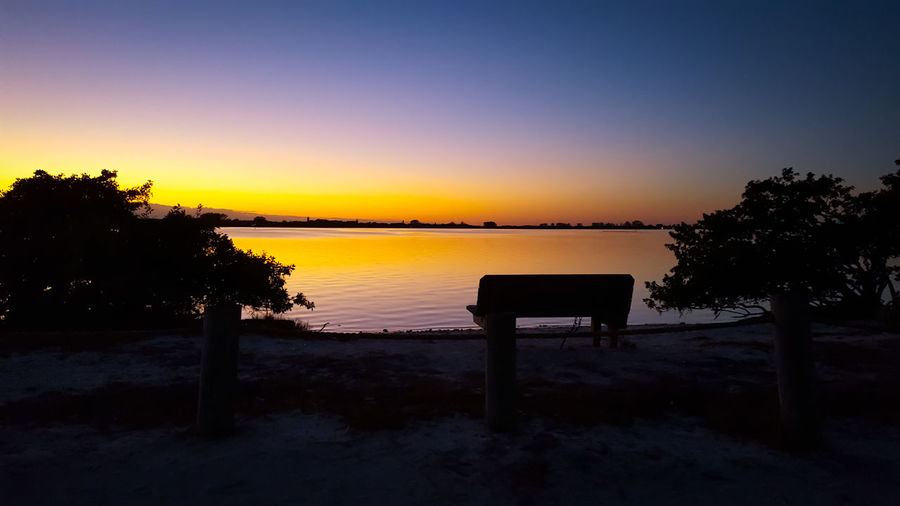 An incredible sunset at Indian Mound Park in Englewood Florida. Bench Englewood Beauty In Nature Dusk Evening Florida Indian Mound Park Landscapes Nature No People Outdoors Park Scenics Silhouette Sky Sunset Tranquil Scene Tranquility Tree Water