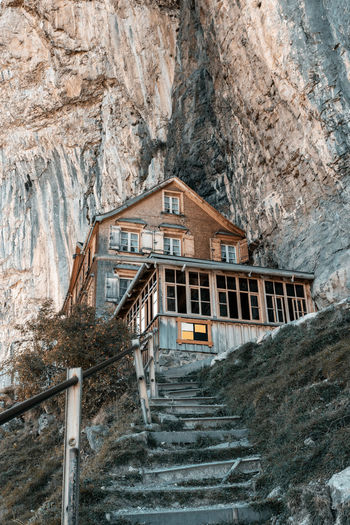 Low angle view of staircase and building against mountain