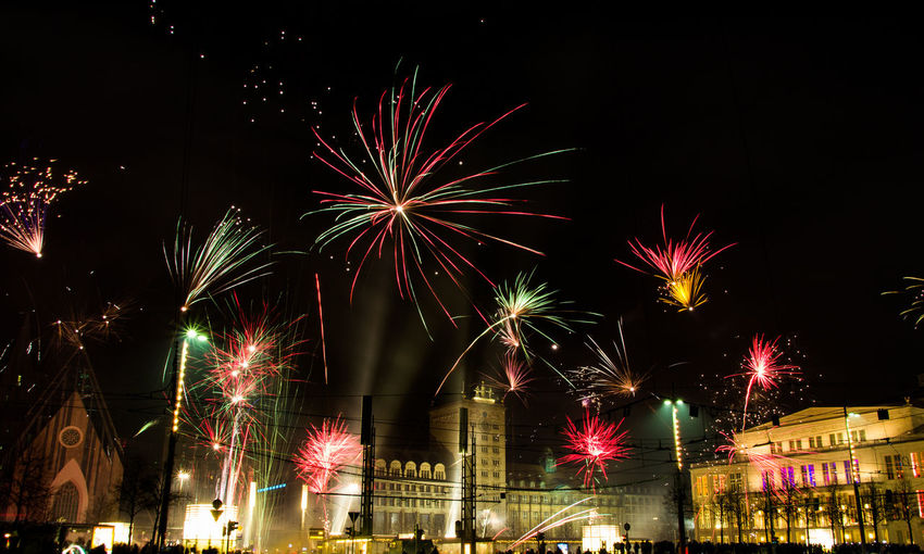 New Year Architecture Arts Culture And Entertainment Blurred Motion Building Exterior Built Structure Celebration City Cityscape Event Exploding Firework Firework - Man Made Object Firework Display Illuminated Long Exposure Low Angle View Motion Multi Colored Night No People Outdoors Sky