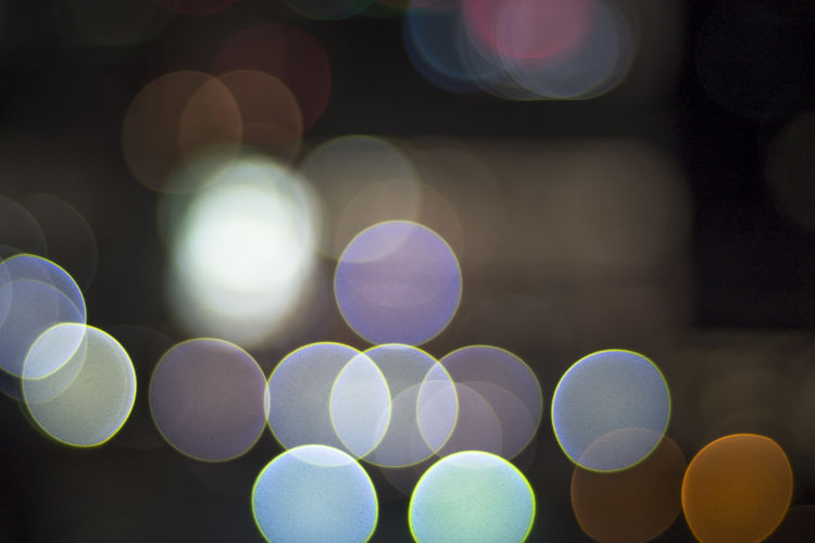 Bokeh light Circle background Illuminated Defocused Circle Lens Flare Geometric Shape Glowing Shape Night Abstract Pattern Lighting Equipment Light - Natural Phenomenon No People Light Design Backgrounds Electric Light Multi Colored Close-up Full Frame