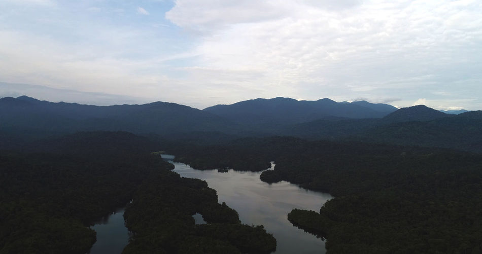 A view of a lake which acts as water supply to the nearby township. Aerial, Tree, Landscape, Background, Nature, View, Green, Outdoor, Park, Forest, Land, Environment, Field, Season, Country, Travel, Beautiful, Scenery, Hill, Drone, Mountain, Panoramic, Above, Jungle, Woods, Destination, Tropical, Horizon, Wild, Breathtak Beauty In Nature Day Mountain Mountain Range Nature No People Outdoors Scenics Silhouette Sky Tranquil Scene Tranquility Water