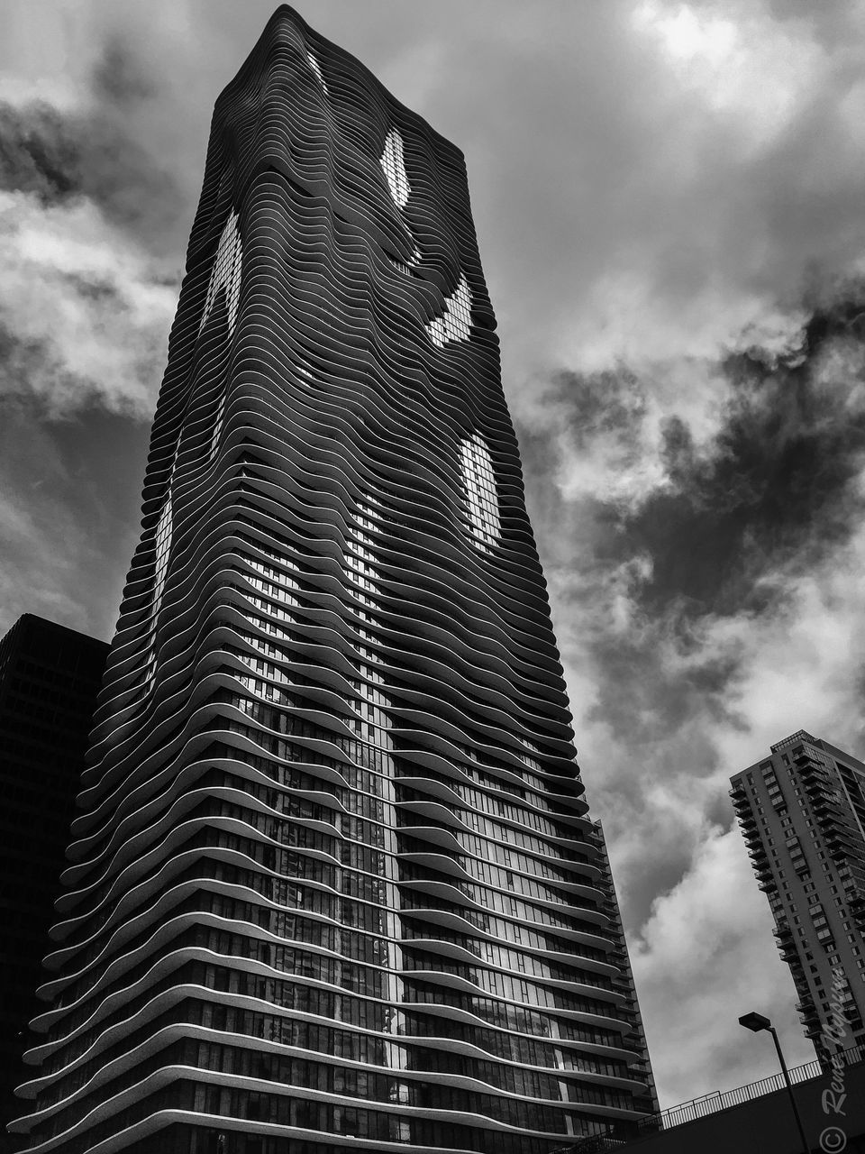 architecture, low angle view, skyscraper, building exterior, built structure, modern, tall - high, tower, sky, cloud - sky, outdoors, city, tall, no people, day