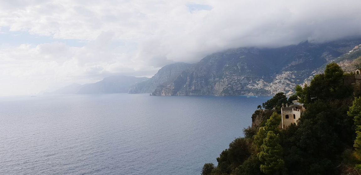 Amalfi coastline Water Tree Mountain Sea Beach Cliff Sky Landscape Cloud - Sky Horizon Over Water Sky Only Foggy Dramatic Sky Rocky Mountains Mountain Peak Rocky Coastline Atmospheric Mood Rock Formation Geology
