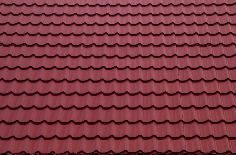 Red roofing from stainless metal plate, metal tile. Abundance Architecture Arrangement Backgrounds Close-up Day Design Full Frame Geometric Shape In A Row Indoors  Large Group Of Objects No People Pattern Pink Color Purple Red Repetition Roof Tile Shape Textured
