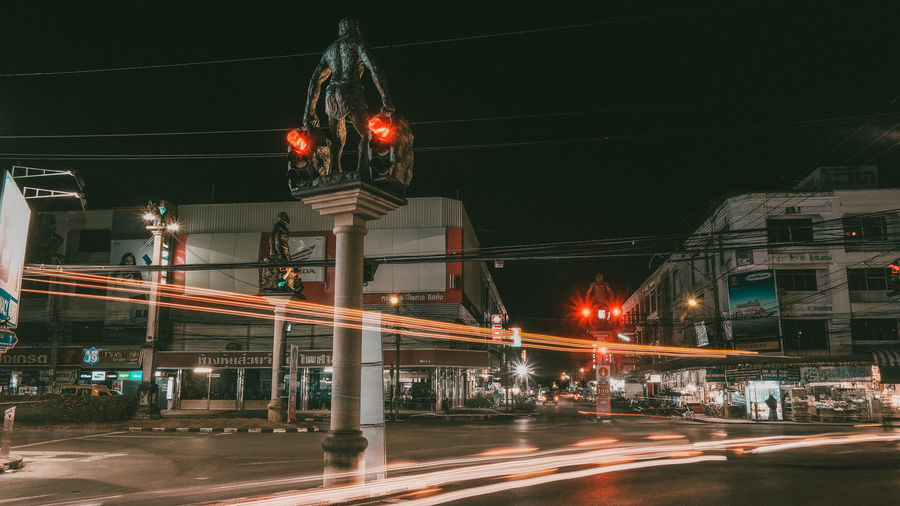 Blurred Motion Of Cars On City Street At Night