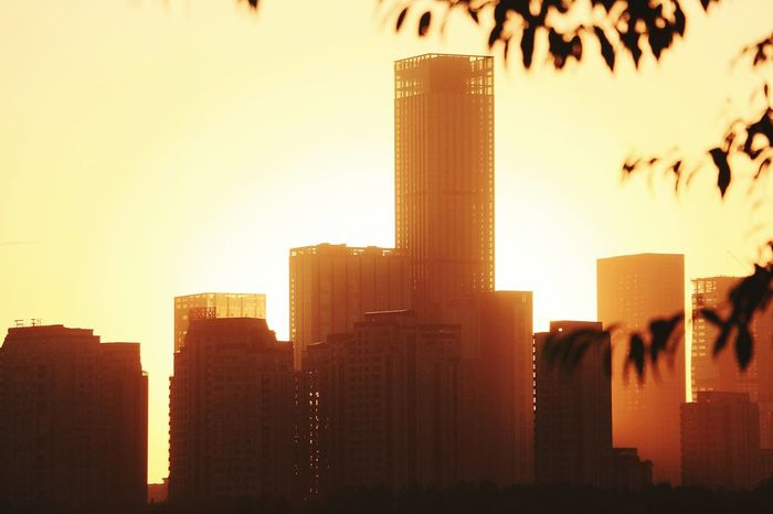 Skyscraper Architecture City Urban Skyline Building Exterior Cityscape Sunset Downtown District Sky Built Structure Outdoors City Life No People Travel Destinations Modern Illuminated Night