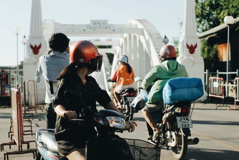 Transportation Mode Of Transport Day Real People Land Vehicle Architecture Building Exterior Motorcycle Built Structure Bicycle Outdoors Men Helmet Sitting Police Force Adult City People Sky Adults Only Lampang Lampang | Thailand Thailand Bridge