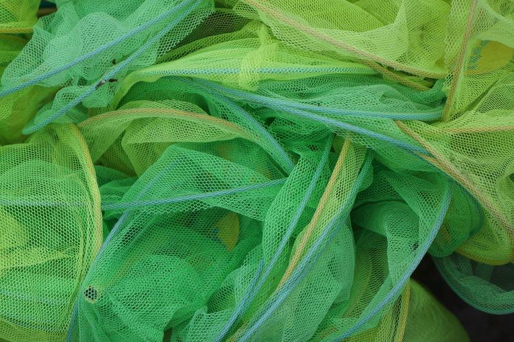 Full Frame Shot Of Green Fishing Nets