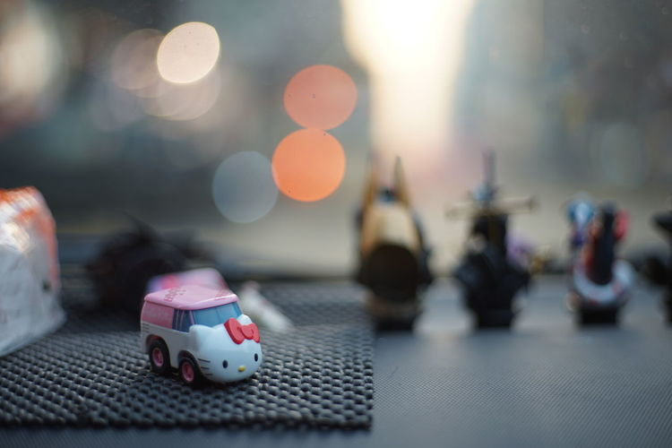 Art And Craft Car Close-up Creativity Day Figurine  Focus On Foreground Hallo Kitty Hallo Kitty Kitty Human Representation Indoors  Lens Flare Mammal Nature No People Representation Selective Focus Still Life Surface Level Table Toy