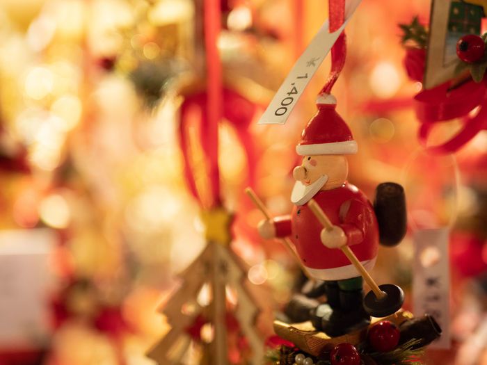 Holiday Retail  Decoration Hanging Focus On Foreground Celebration Market No People Text Selective Focus For Sale Christmas Art And Craft Choice Business Close-up Red Christmas Decoration Retail Display Christmas Ornament Festival