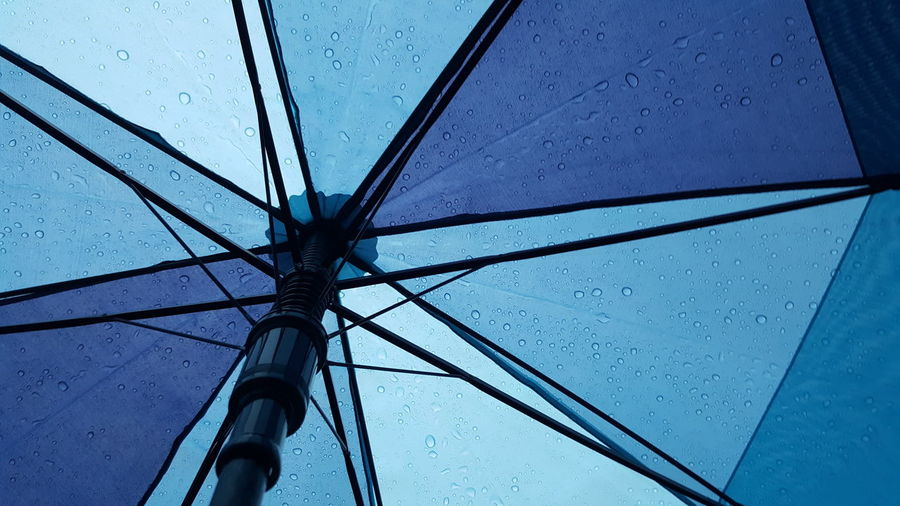 Umbrella. Low Angle View Rain Wet No People Close-up Umbrella Rainy Blue Umbrella Blue Blue Color