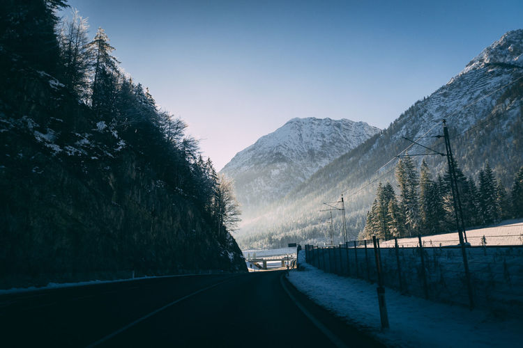 Skiing Trip Beauty In Nature Car Clear Sky Cold Temperature Day Landscape Mountain Mountain Range Nature No People Outdoors Road Scenics Sky Snow The Way Forward Tranquil Scene Tranquility Transportation Tree Winter