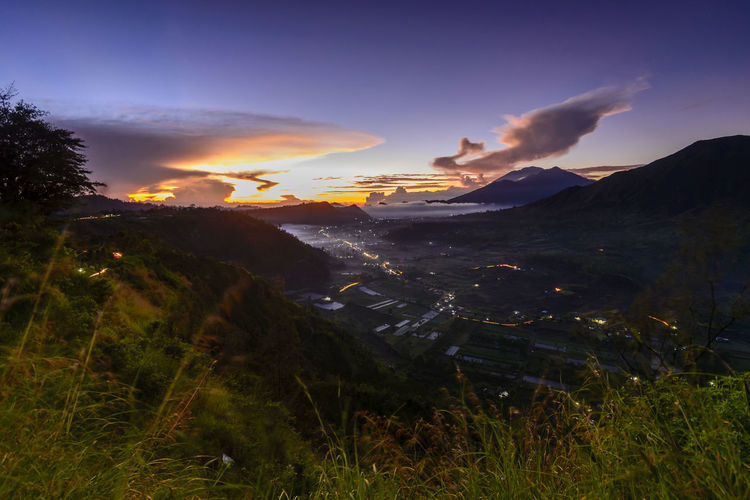 mountain view with sunrise background,bali,indonesia. Bali Bali Indonesia EyeEm Best Shots EyeEm Nature Lover EyeEmNewHere Kintamani - Bali Beauty In Nature Day Grass Landscape Mountain Nature No People Outdoors Power In Nature Scenics Sky Sunrise Background Sunset Tranquility Tree