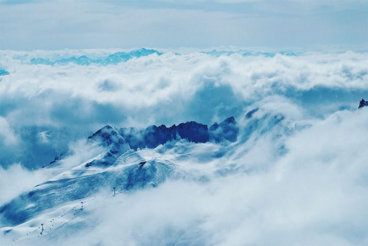 Scenics Beauty In Nature Tranquil Scene Mountain Majestic Idyllic Tranquility Nature Cloud - Sky Cloudscape Aerial View Softness Mountain Range Non-urban Scene Day Travel Destinations Mountain Peak Fluffy High Up Outdoors