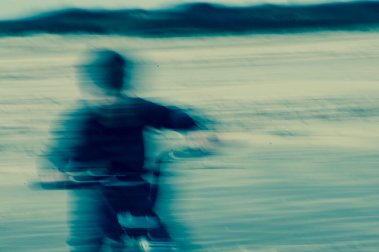 Blurred motion of man on shore