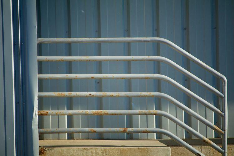 Full frame shot of railing against building