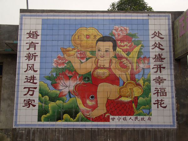 Architecture Art And Craft Building Exterior Built Structure China Close-up Communication Day Human Representation Multi Colored No People One Child Policy Outdoors Propaganda Text