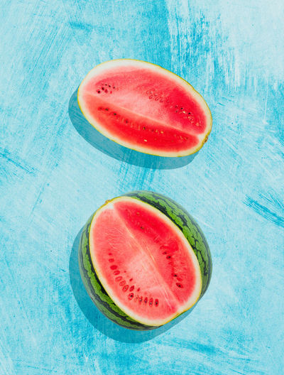 Pieces of watermelon on background painted in blue Food Fruit Ripe No People SLICE Watermelon Freshness Wellbeing Healthy Eating Diet Clean Freshness Fresh Fruity Sweet Summer Organic Natural Ingredient Green Melon Lay Flat Vegetarian