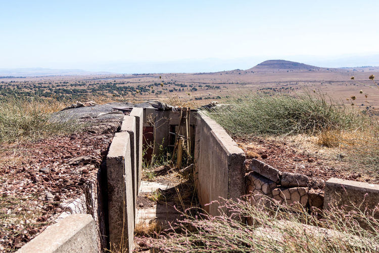 Old abandoned trenches from the time of the Yom Kippur War on the Golan Heights, near the border with Syria, in Israel Battlefield Fortifications Golan Heights Soldier Syria  Yom Kippur War Abandoned Armored Army Border Building Combat Conflict Day Devastated Fortress History Israel Military Nature Protection Sky Trench War Weapon