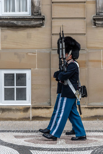 Soldiers wearing traditional uniforms guarding Amalienborg Palace in Copenhagen Amalienborg Architecture Army Army Soldier Building Exterior Built Structure Day Full Length Guarding Guards Gun Men Military Outdoors Real People Royalty Soldier Standing Terrorism Tourism Tourist Attraction  Traditional Traditional Clothing Travel Travel Destinations