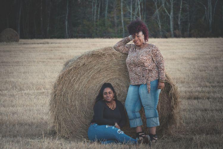 Portrait of women in hay field.