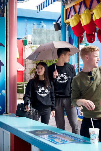 A couple wear matching jumpers on their day out to Ocean Park. Affection Candid Casual Clothing Couple Fair Fun Hong Kong Love Matching Outfits Ocean Park Relationship Romance Side By Side Twins Umbrella Up Close Street Photography Two Is Better Than One