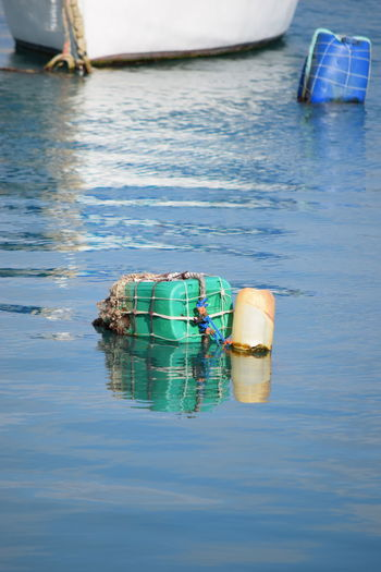 Various Bottles recycled as Mooring Buoys for boats Bottle Buoy Container Day Environmental Issues Floating Floating On Water Mode Of Transportation Nature Nautical Vessel No People Outdoors Reflection Sea Tranquility Transportation Water Waterfront