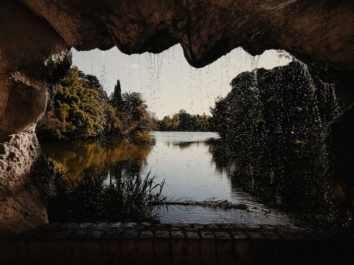 Scenic view of lake seen through cave