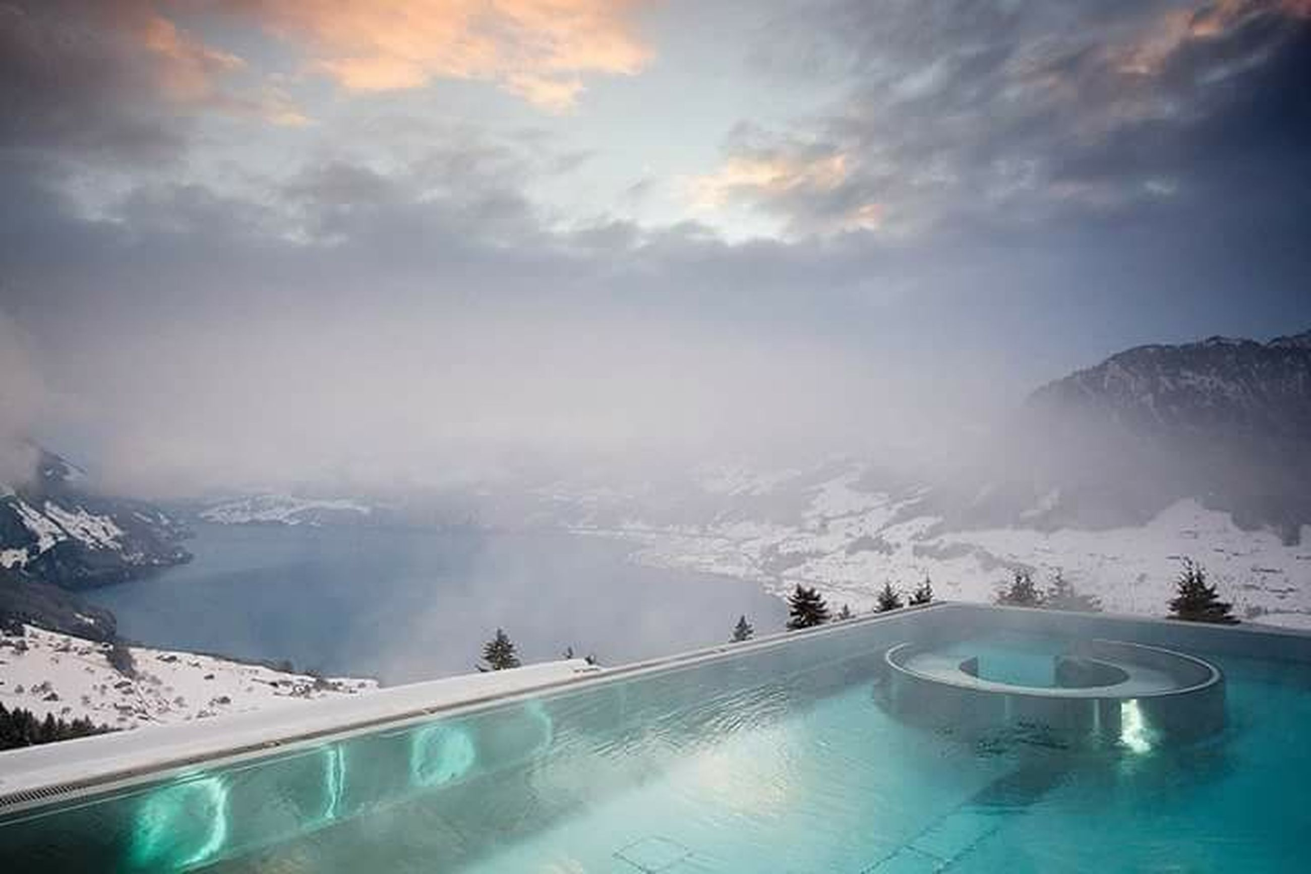 snow, winter, cold temperature, mountain, weather, season, scenics, beauty in nature, sky, mountain range, tranquil scene, transportation, nature, tranquility, cloud - sky, covering, snowcapped mountain, water, mode of transport, frozen