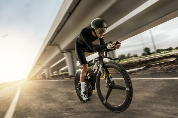 Bicycle Blurred Motion City Cycling Full Length Helmet Leisure Activity Lifestyles Mature Men Men Motion One Person Outdoors Real People Ride Riding Road Speed Sport Sports Clothing Transportation