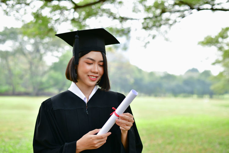 Happy Achievement Beautiful Woman Certificate Degree Diploma Education Educational Emotion Focus On Foreground Graduation Graduation Gown Happiness Holding Learning Mortarboard Outdoors School Smiling Student Success University University Student Young Adult Young Women
