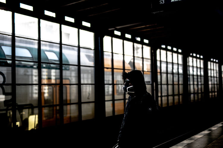 Man wearing mask at railway station