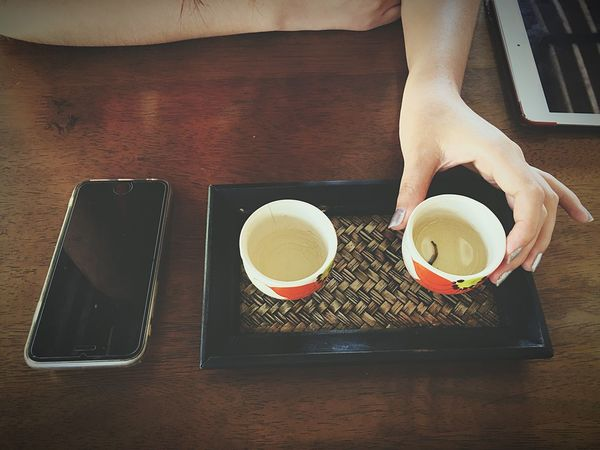 Drink Coffee - Drink Food And Drink Coffee Cup Refreshment Wireless Technology Indoors  Holding Table Frothy Drink Real People Lifestyles Mobile Phone Technology Freshness Human Hand Tea - Hot Drink Human Body Part Low Section