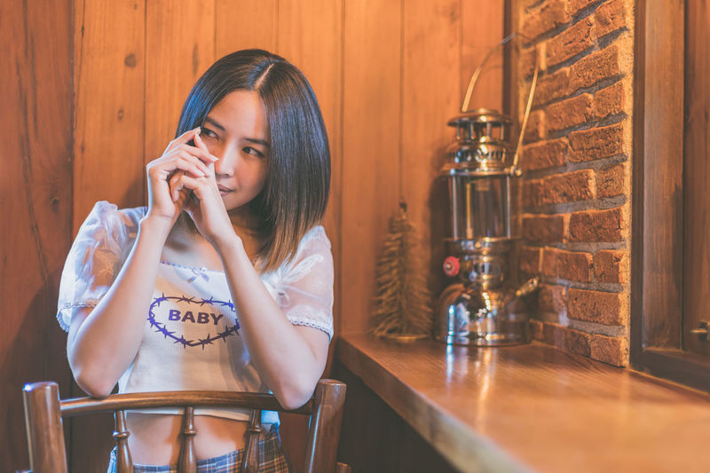Close-up of young woman sitting at cafe