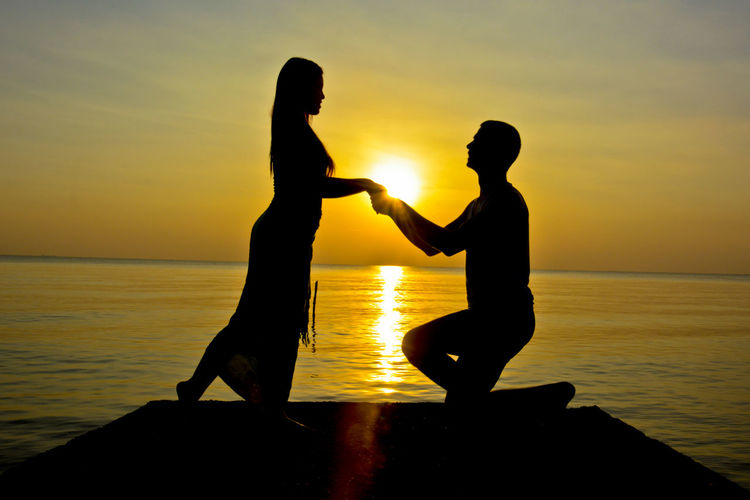 Romantic couple on the beach at sunset time Beach Beach Photography Beautiful Happiness Harmony Honeymoon Honeymooners Island Lifestyles Love Love Marriage  Men Nature Proposal Of Marriage Propose Sea Silhouette Sun Sunset Togetherness Unity Women