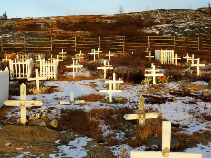 White crosses showing Inuit graves in the Kuujjuaq cemetery Northern Quebec Kuujjuaq Winter Snow Cold Temperature Nature No People Day Water Architecture Plant Built Structure Tree Outdoors Grave Fence Cemetery Sky Mountain Barrier Cemetery Photography Cemetery_shots Cemetery