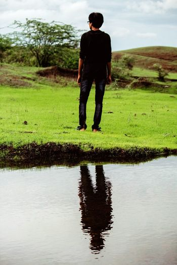 Reflection of man in lake