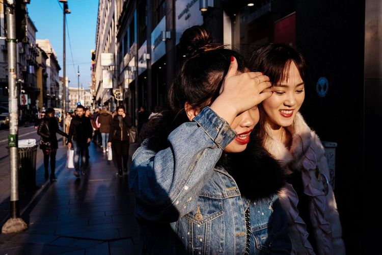 Shopping fever. Real People Young Women Togetherness Young Adult Lifestyles Night Two People Happiness Outdoors Smiling City Building Exterior Women Architecture Friendship People