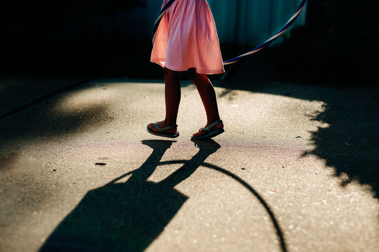 Childhood Girl Hola Hooping Lifestyles Low Section One Person Outdoors Real People Shadow Standing Summer Sunlight