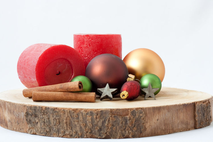 Backgrounds Copy Space White Background StillLifePhotography Lighting Equipment Merry Christmas! Stars Star Christmas Ornament Cinnamon Candle Christmas Lights Christmas Decoration Christmas Wood - Material Red Close-up No People Indoors  Table Still Life Holidays