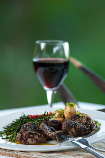 lamb and vine Alcohol Close-up Food Food And Drink Lamb - Meat Lamb And Vine Lamb Chops Main Course Meal Outdoors Ready-to-eat Red Wine Vine 🍷 Wine Wineglass