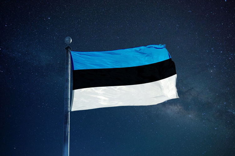 Flag of estonia against star field sky