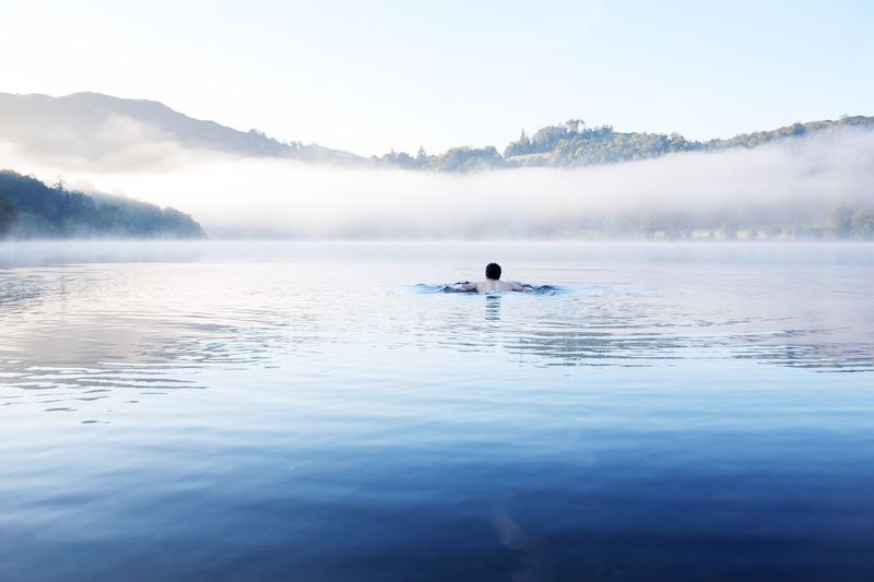 Lake swimming Water Reflection Men Lake One Person Nature Beauty In Nature Waterfront Rear View Day Scenics Real People Outdoors Fog One Man Only Sky Only Men Young Adult People Lake District National Park Swimming In The Lake Cold Water Swimming Fresh On Market 2017